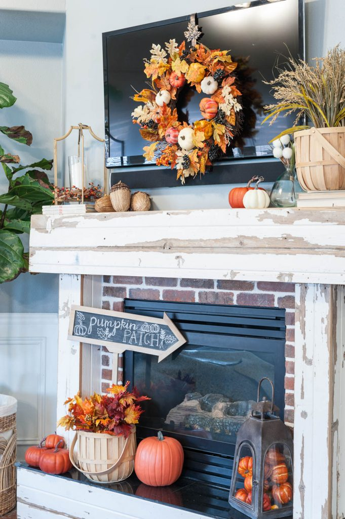 fall mantle decorating ideas with pumpkins leaves and wheat all